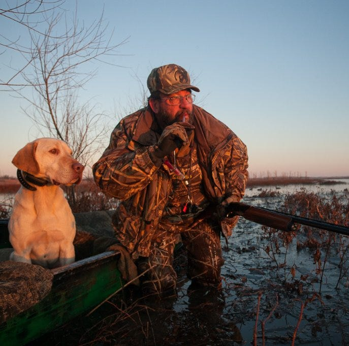 A duck hunter, grandson and old retriever have grand start to season