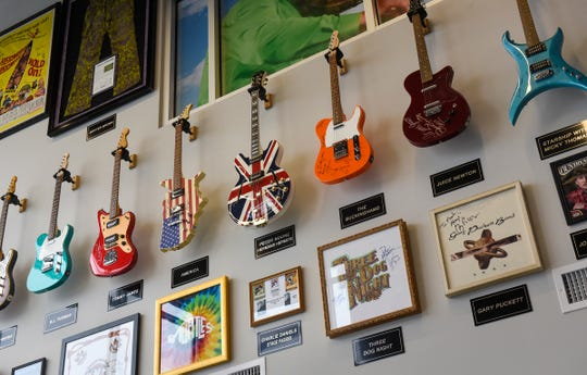 Guitars representing past performers at the Liberty Bank Block Party are on display in the bank's new community room Monday, Dec. 3, in St. Cloud.