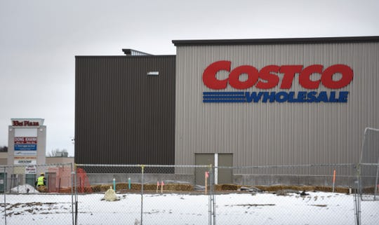 A worker walks past a portion of the new Costco building currently under construction Monday, Dec. 3, in St. Cloud.