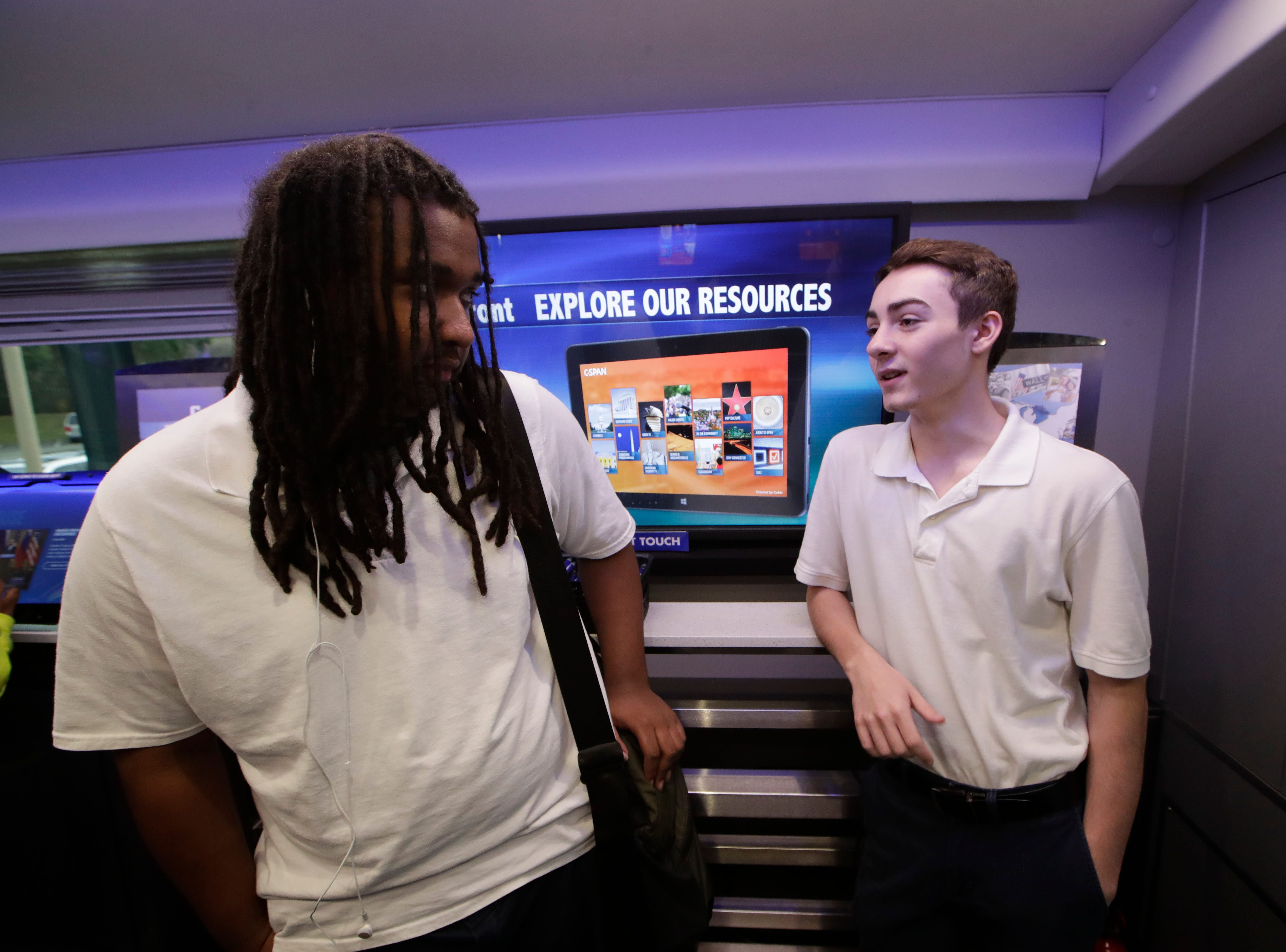 Johnathan Ferrell, 17, left and Jordan Johnson, 17, talk about what they learned on the C-SPAN bus as it makes a stop at the Ghazvini Learning Center in Tallahassee, allowing Success Academy and Second Chance students to come aboard the bus and learn about C-SPAN Monday, Dec. 3, 2018.