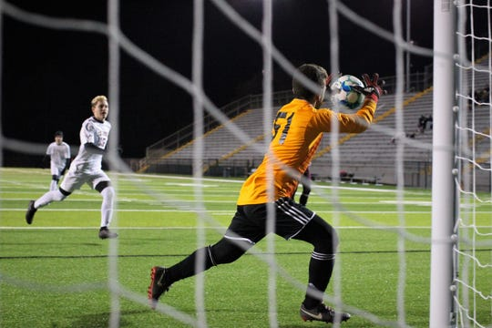 Chiles senior goalie Abraheim Darwish fields a shot off the turf as Chiles plays Lake City Columbia to a 0-0 draw during a regular season game at Gene Cox Stadium.