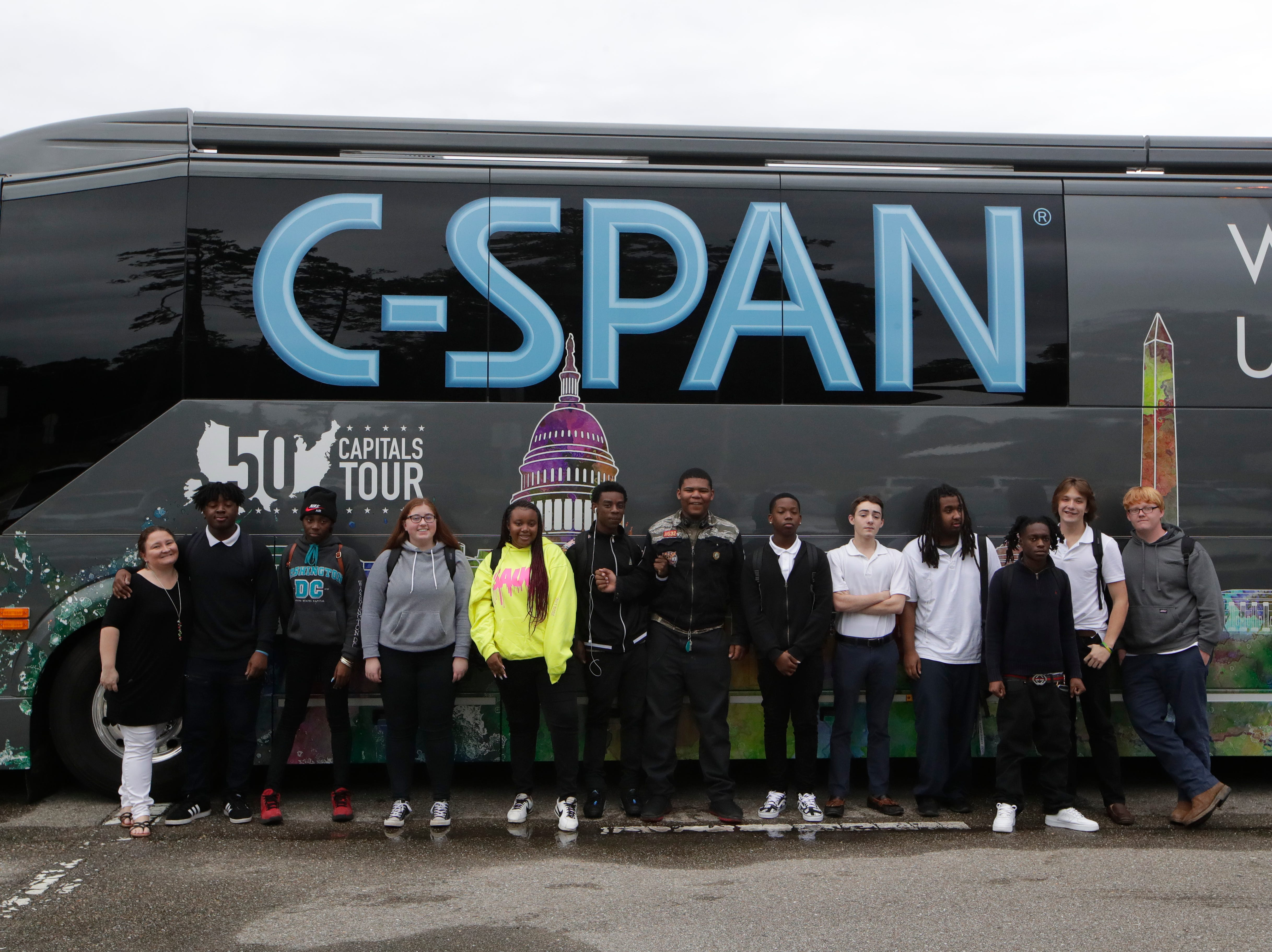 Students from Success Academy's April Gibbs government class for junior and seniors pose in front of the C-SPAN bus as it makes a stop at the Ghazvini Learning Center in Tallahassee, allowing Success Academy and Second Chance students to come aboard the bus and learn about C-SPAN Monday, Dec. 3, 2018.