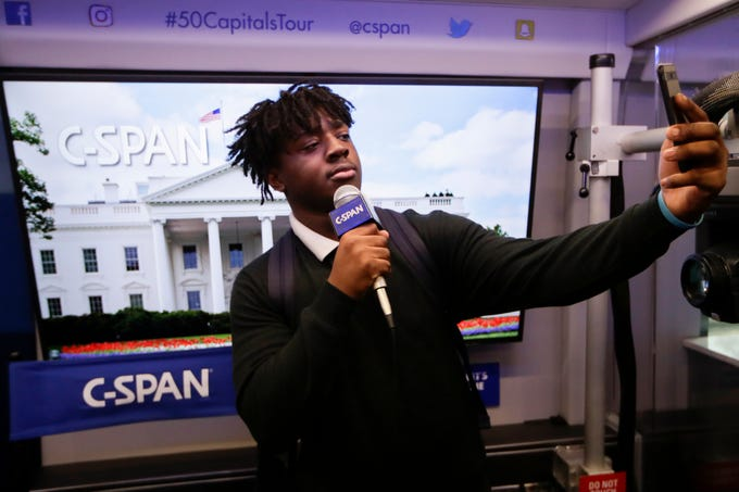 Lebaron Bowdry, 18, takes a selfie aboard the C-SPAN bus as it makes a stop at the Ghazvini Learning Center in Tallahassee, allowing Success Academy and Second Chance students to come aboard the bus and learn about C-SPAN Monday, Dec. 3, 2018.