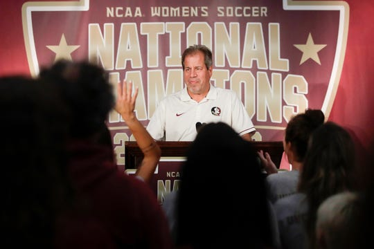 Florida State University Women's Soccer Head Coach Mark Krikorian gets a standing ovation as he takes the stage at a ceremony honoring the FSU women's soccer team as the 2018 NCAA National Champions in the Champions Club West at Doak Campbell Stadium Monday, Dec. 3, 2018.