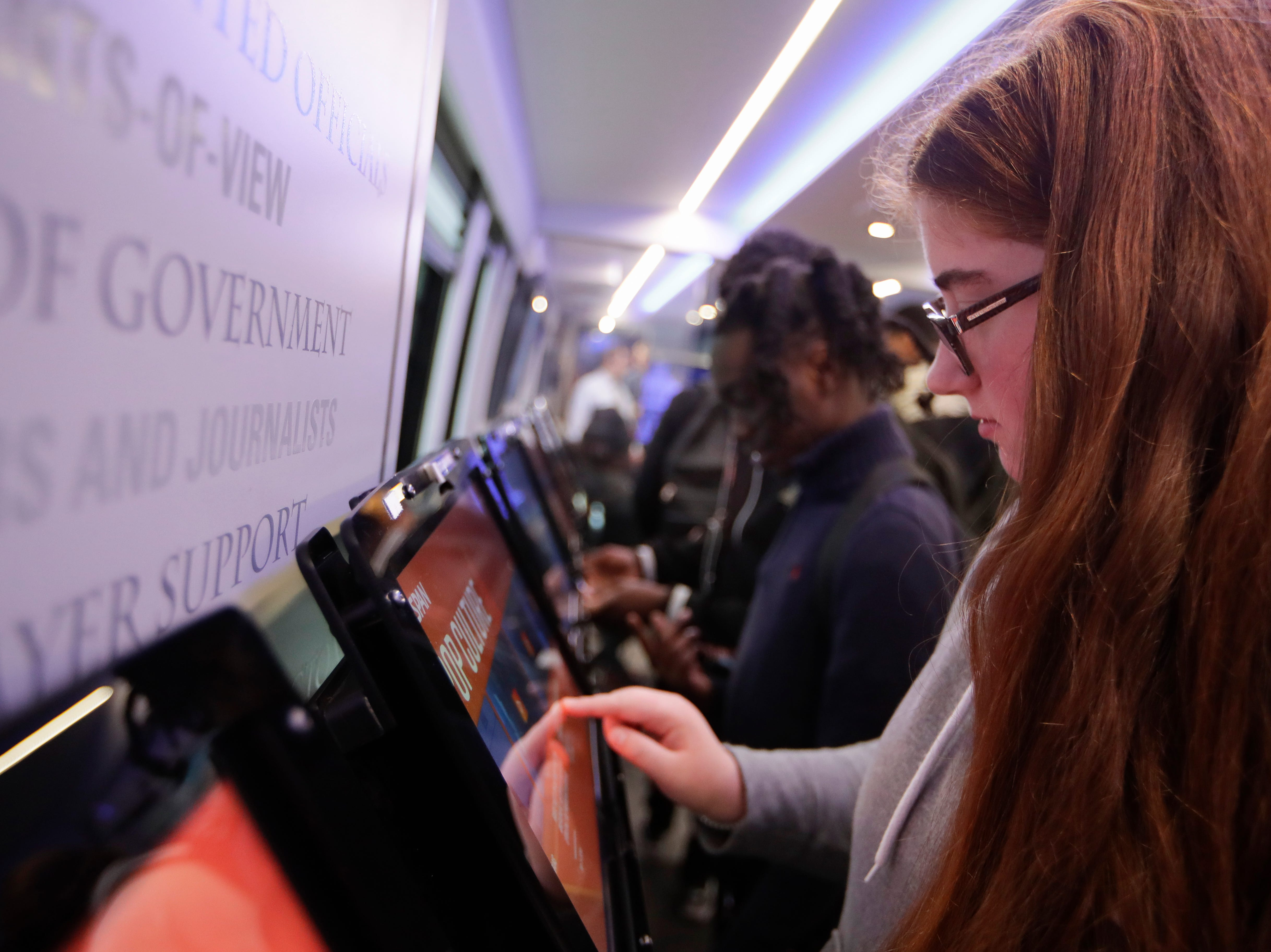 Casey Knowles, 17, scrolls through the choices of activities on the tablets inside the C-SPAN bus as it makes a stop at the Ghazvini Learning Center in Tallahassee, allowing Success Academy and Second Chance students to come aboard the bus and learn about C-SPAN Monday, Dec. 3, 2018.