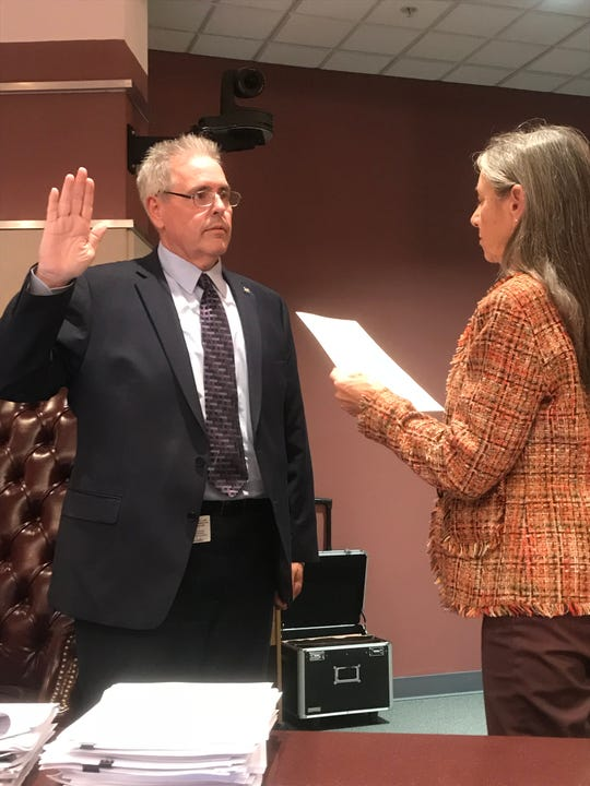 Jim Stokes is sworn in as Port St. Lucie interim city attorney by Clerk Karen Phillips on Feb. 26, 2018.