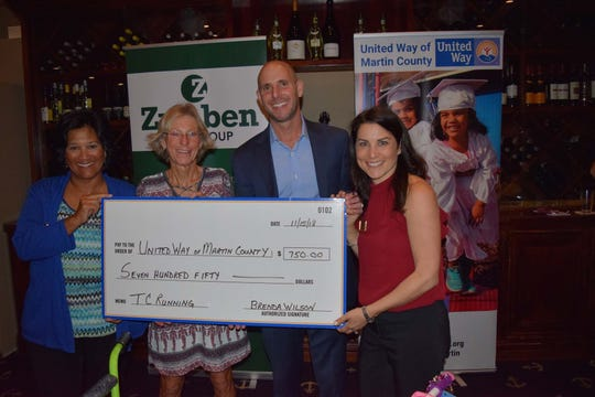 Treasure Coast Running made a large donation to the project. From left are Carol G. Houwaart-Diez, Brenda Wilson and Gene and Tara Zweben.