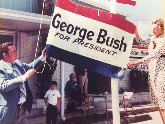 Bill Jordan, left, helps Dorothy Walker Bush raise a campaign flag for her son outside Jordan Sprinklers in Vero Beach in 1979.  Jordan was campaign chair in Indian River County for George H.W. Bush's GOP primary in 1980.