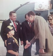 George Bush, then vice president, prepares to shake the hand of Billy Jordan, son of Bush's Indian River County campaign chair Bill Jordan, during a mid-1980s stop at Witham Field in Stuart.