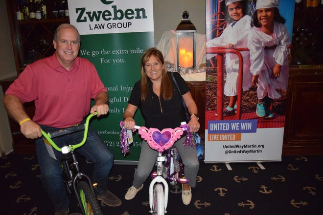 The goal is to raise enough money for 300 bikes for children in need through United Way's White Doves Holiday Project. Ed and Liz Ciampi are supporters.