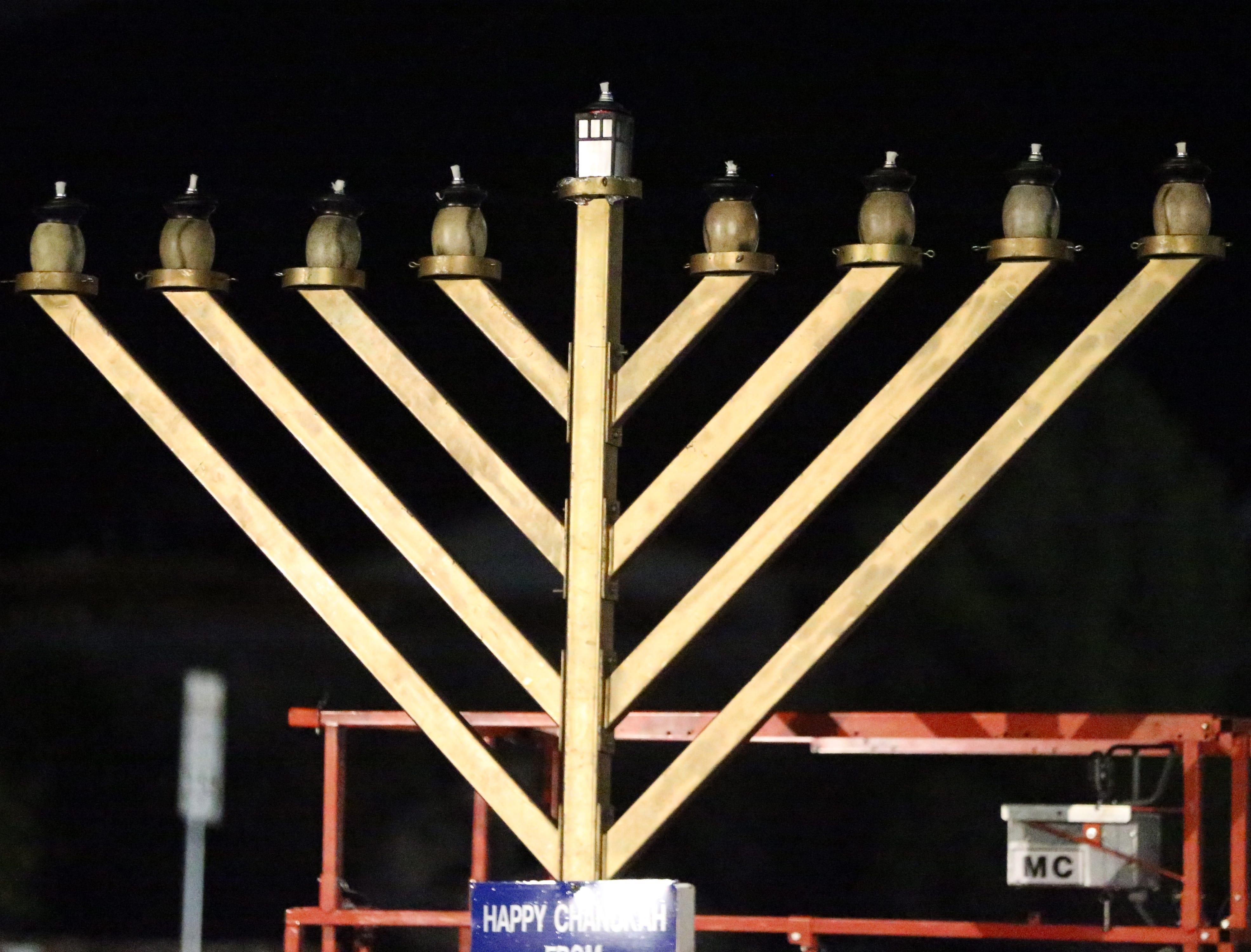 A large menorah outside Chabad Lubavitch of El Paso was lit Sunday night.