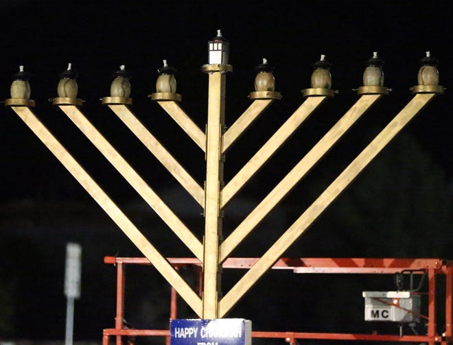 A large menorah outside Chabad Lubavitch of El Paso.