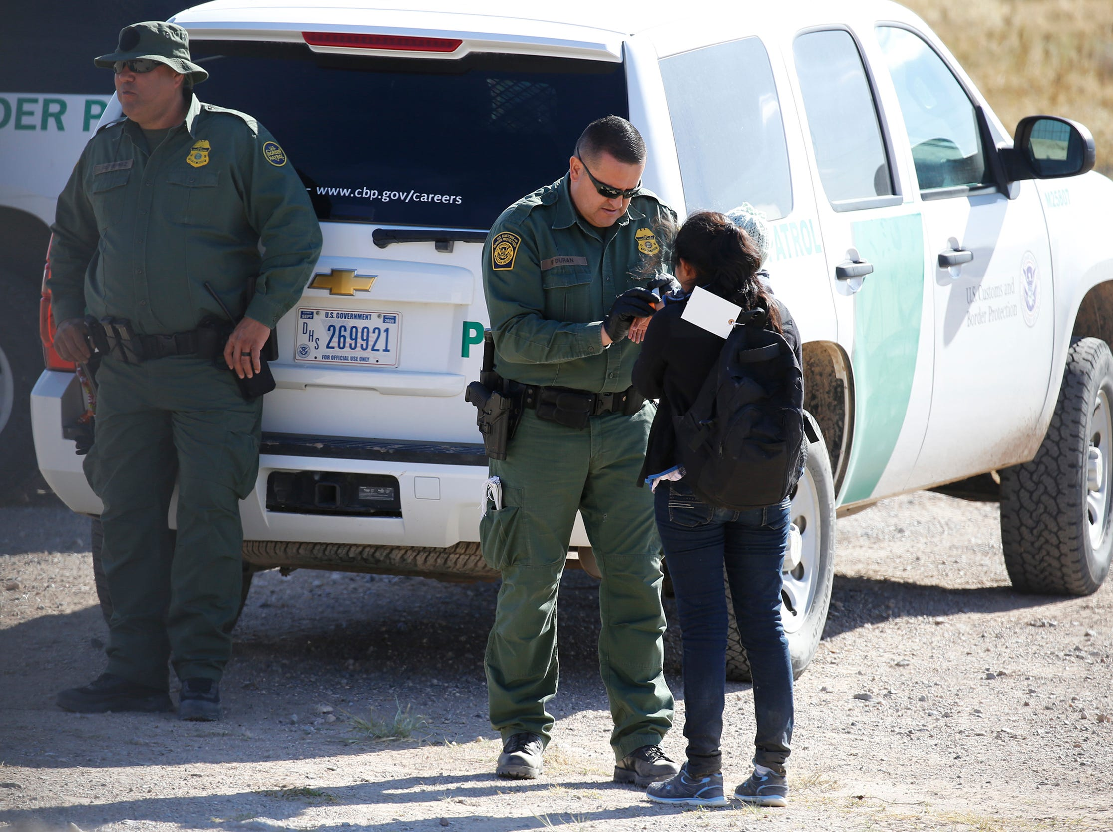A large group of migrants were detained by Border Patrol Monday at the border fence along the Border Highway near Fonseca.