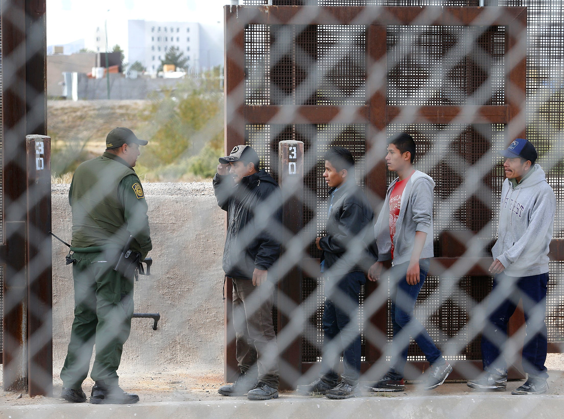 Border Patrol detains a large group of migrants near El Paso earlier this year.