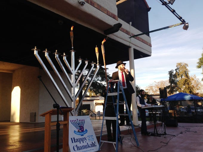 Rabbi Aryeh Lang stands next to the 9-foot-tall menorah on Sunday at Chabad of Camarillo's 16th annual Hanukkah Festival and Grand Menorah Lighting in Constitution Park in Camarillo.