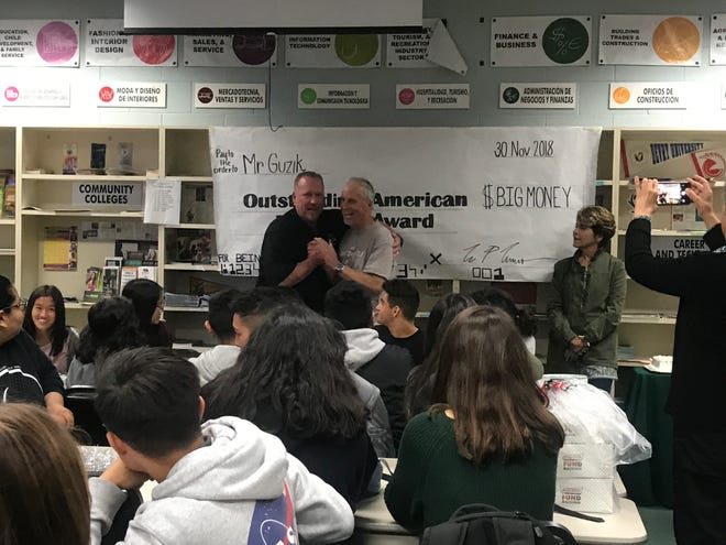 Randy Guzik was honored at Pacifica High School Friday for an award he recently received recognizing him for being an outstanding educator.
