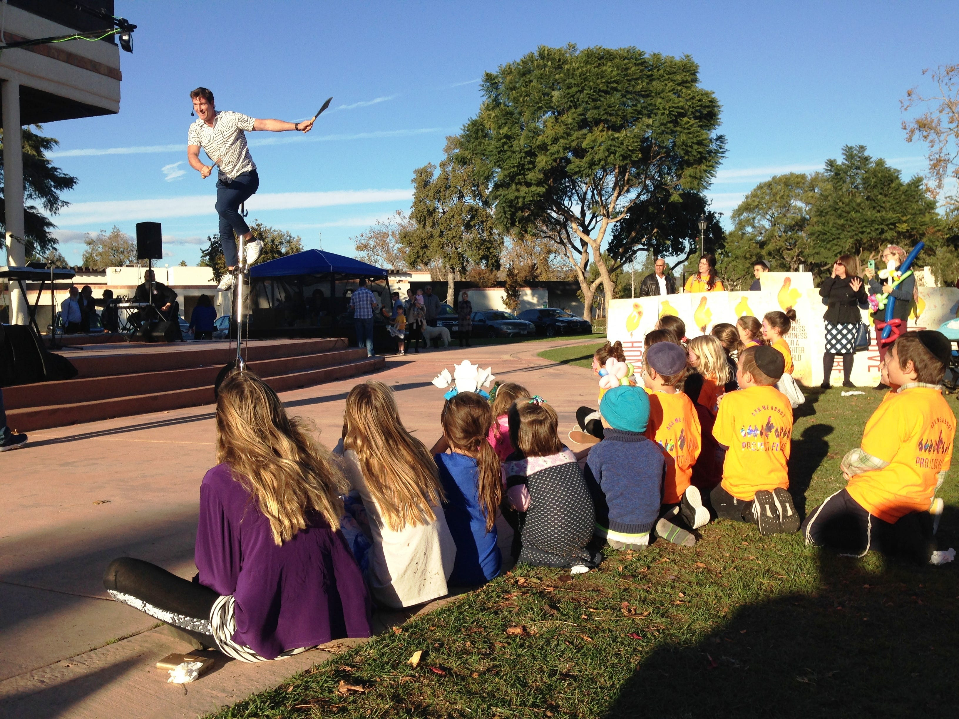 Patrick Connor, a juggler and comedian who lives in Marina Del Rey, performs for children on Sunday at Chabad of Camarillo's 16th annual Hanukkah Festival and Grand Menorah Lighting in Constitution Park in Camarillo.