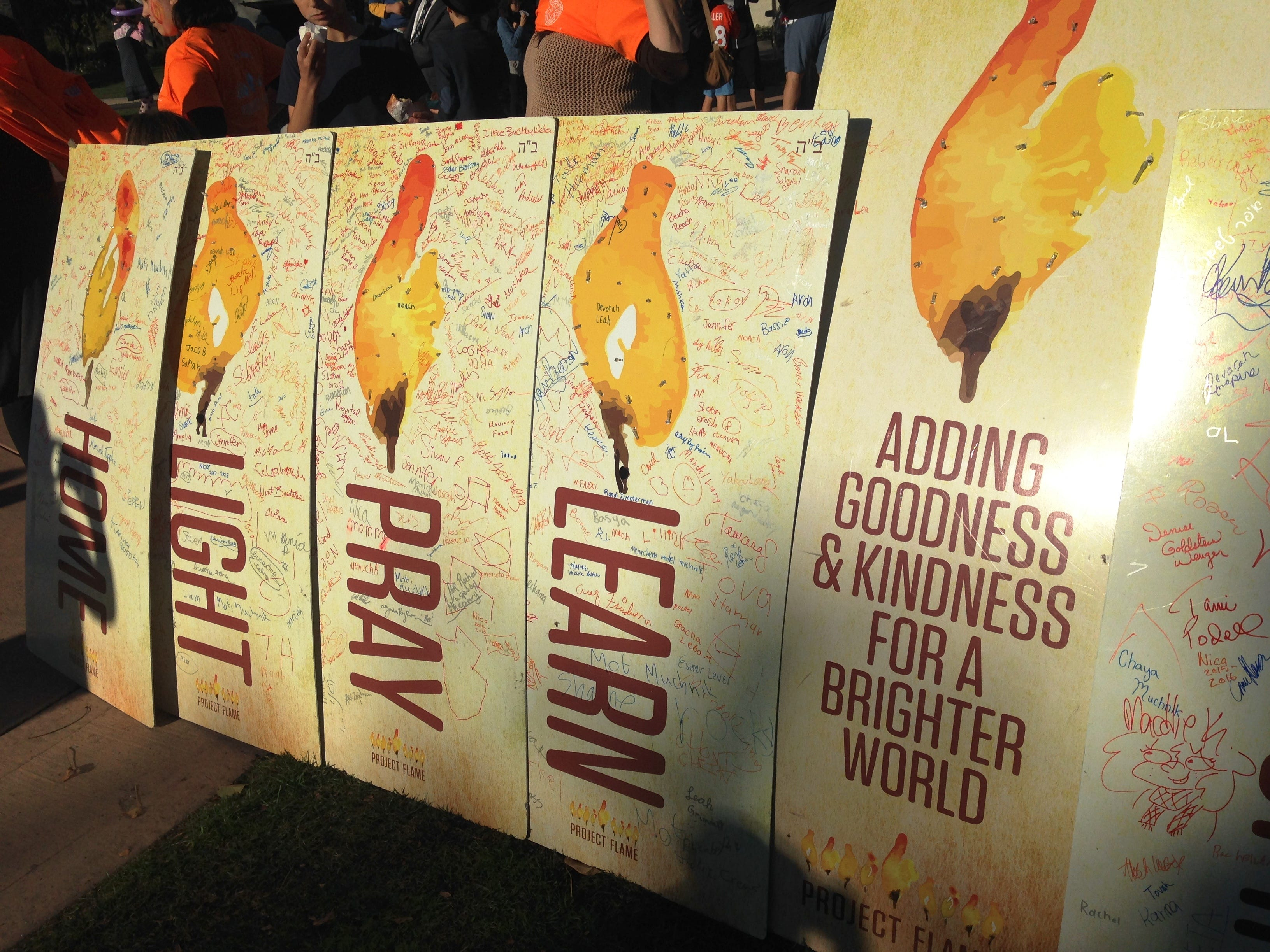 Uplifting signage Is on display Sunday at Chabad of Camarillo's 16th annual Hanukkah Festival and Grand Menorah Lighting in Constitution Park in Camarillo.