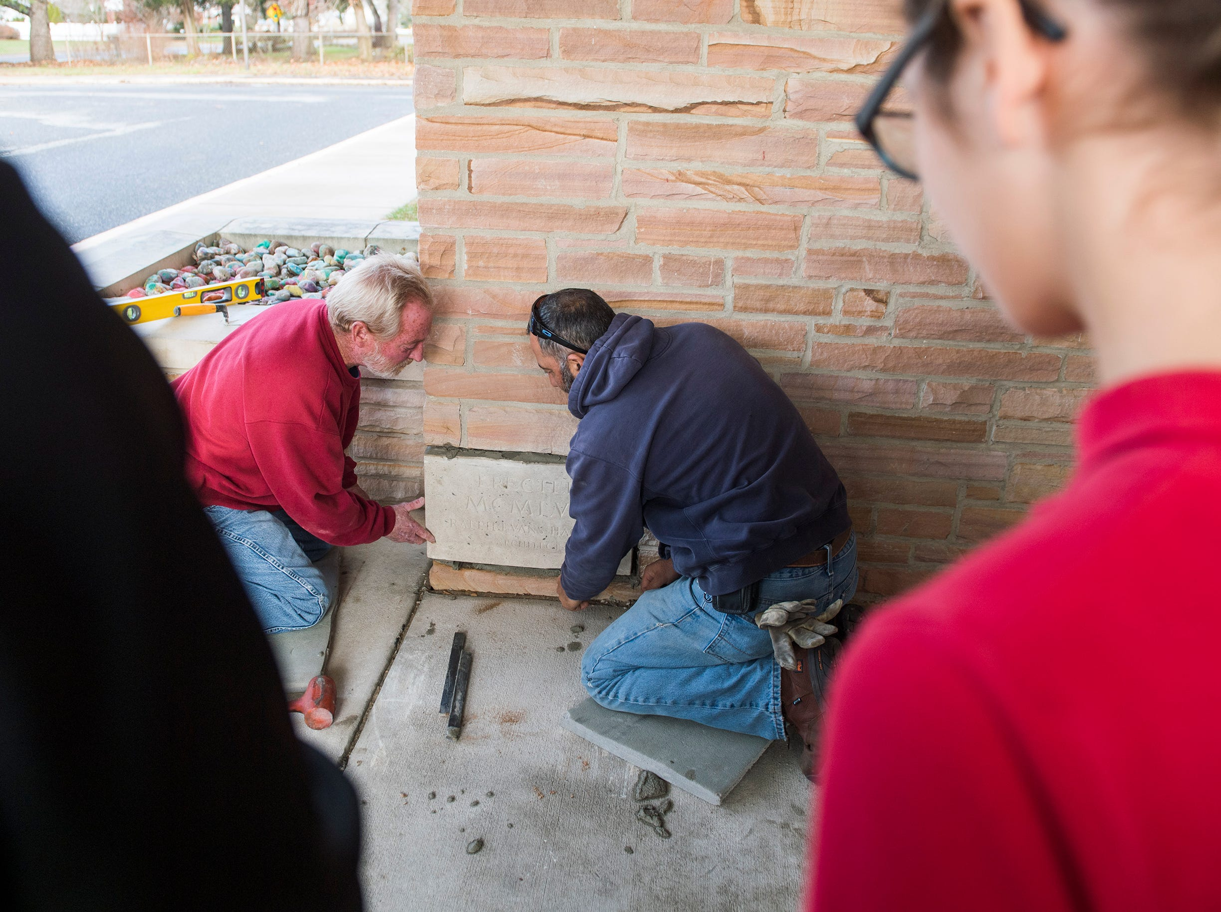 The cornerstone is put back in place after modern additions were made to a time capsule from 1957 Monday, Dec. 3, 2018 at Johnstone Elementary School in Vineland, N.J.