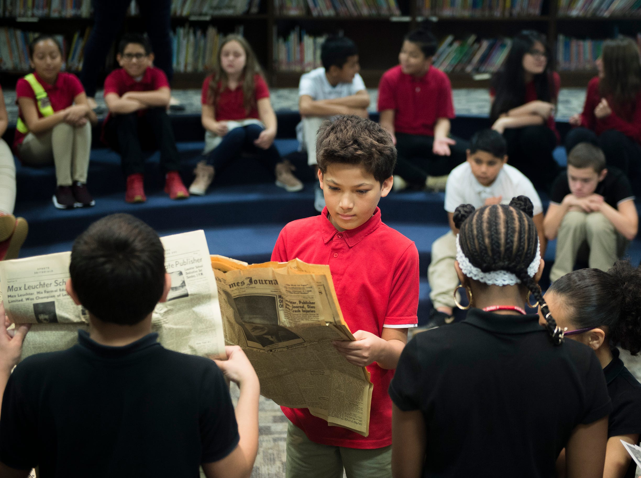 Students look over the contents of a time capsule from 1956 at Marie Durand Elementary School Monday, Dec. 3, 2018 in Vineland, N.J.