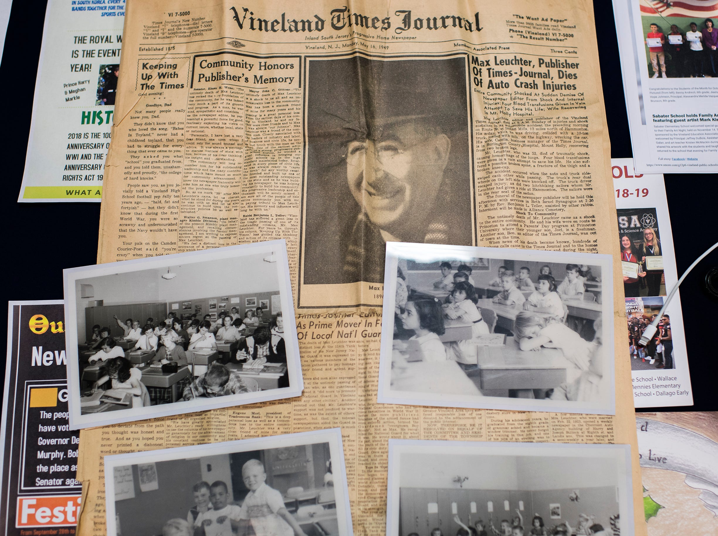 A newspaper dating back to 1949, among photographs are taken out of a time capsule at Marie Durand Elementary School Monday, Dec. 3, 2018 in Vineland, N.J.