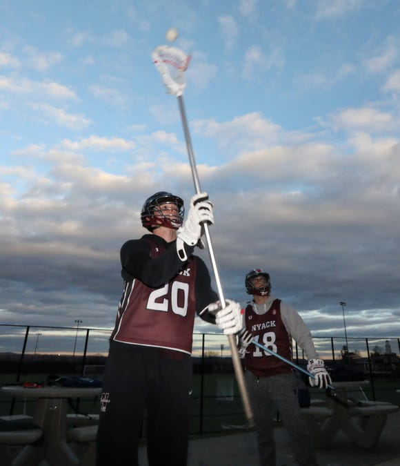 Nyack lacrosse players Jack Kushner, left, and Emril Radoncic use the Snypr app to track wall ball reps Dec. 3, 2018.