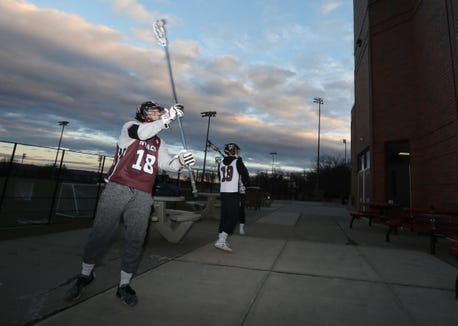 Nyack lacrosse players Emril Radoncic, left, and Conor Murphy use the Snypr app to track wall ball reps Dec. 3, 2018.