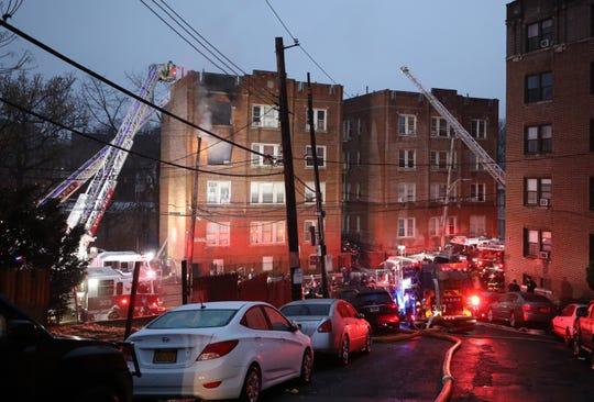 Yonkers firefighters battle a 3-alarm fire at 637 Van Cortlandt Park Avenue, Dec. 2, 2018.