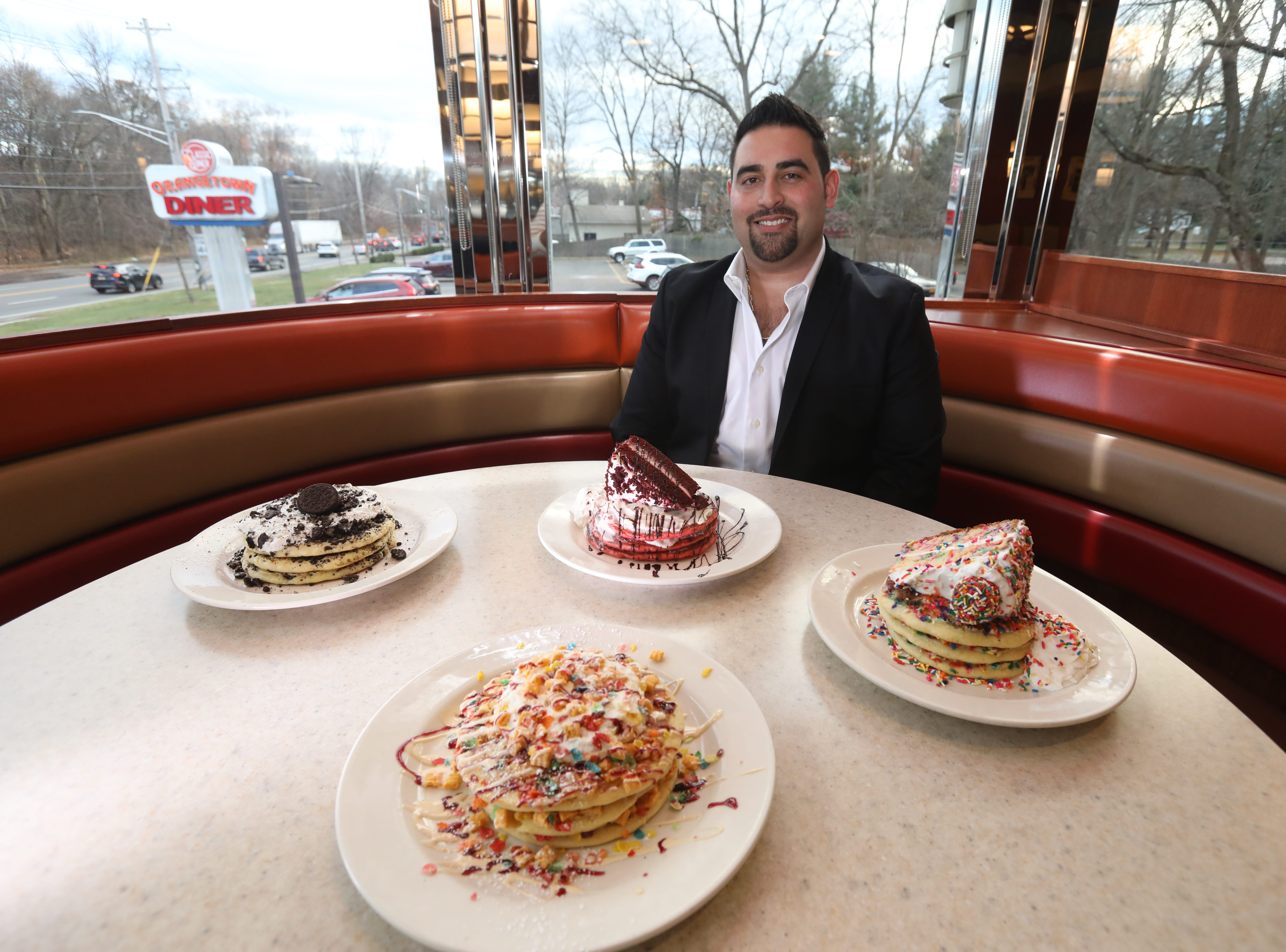Mike Kontolios, owner of Orangeburg Classic Diner created  funfetti, Oreo, red velvet and cereal bowl versions of pancakes for his costumers at his diner Nov. 29, 2018.