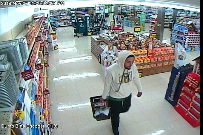 In November, this man stole approximately $115 worth of food from a local grocery store, police say. The suspect fled in an older model Chevrolet sedan with tinted windows and a damaged muffler.