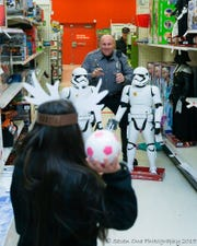 Dover police officers get excited to shop with the kids, playing in the aisles and dancing to holiday music during the annual fundraiser.