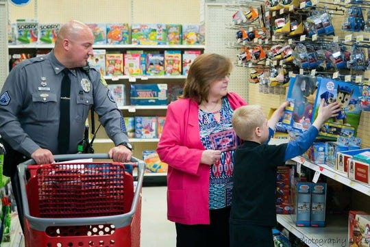 Officers take children and their families shopping at Target each year as part of the Holiday Heroes program. This photo was taken in 2015.
