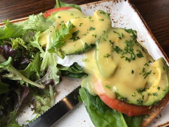 Eggs Benedict with tomatoes, avocado, spinach and hollandaise at the new First State eatery come with either a side of potatoes or a tossed salad. We got the greens.