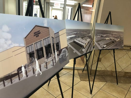 An artistic rendering of the entry and aerial views of the future Wichita County Law Enforcement Center are seen in the lobby of the Wichita county Courthouse. The commissioners court approved Monday the guaranteed maximum price of the project at $70 million.