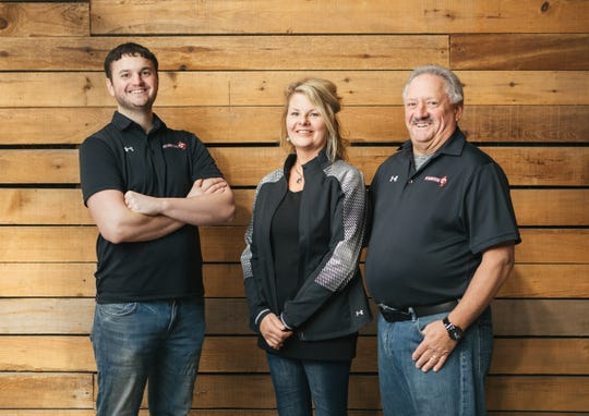 Three proud proprietors of Schumitsch Seed Inc. include, from left to right, Jay, Penny and Scott Schumitsch.