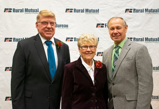 Wisconsin Farm Bureau Federation President Jim Holte poses for a photo with Don and Beverly Meyer at the WFBF Annual Meeting.