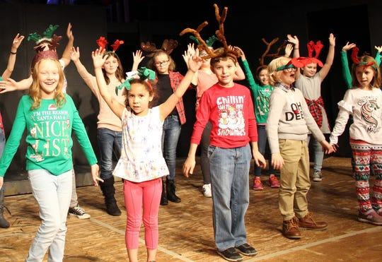 Children rehearse for the upcoming Angel Tree Benefit show at the Renner Theatre.