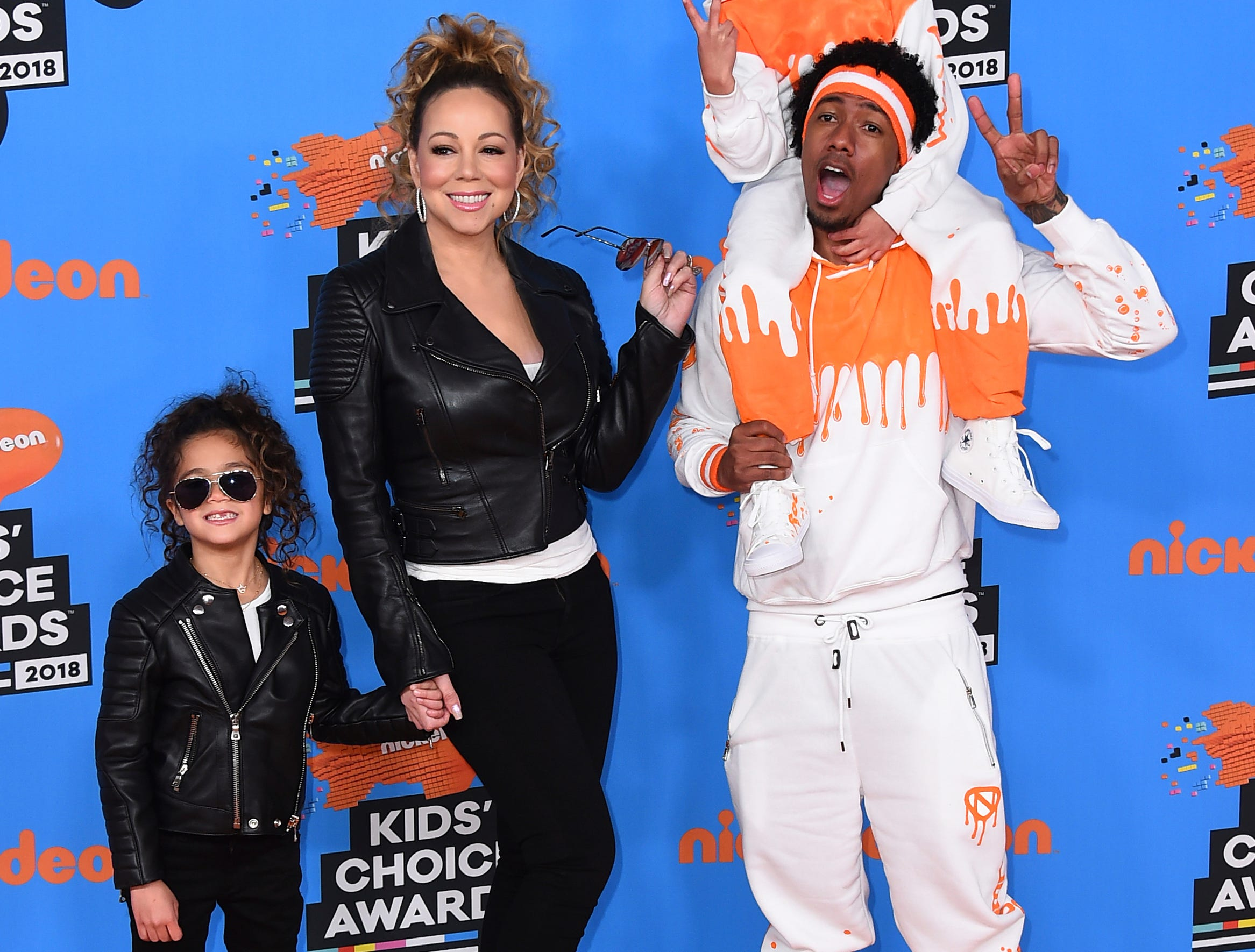 Mariah Carey, center left, Nick Cannon, center right, and from left, their children Monroe and Moroccan arrive at the Kids' Choice Awards at The Forum on Saturday, March 24, 2018, in Inglewood, Calif. (Photo by Jordan Strauss/Invision/AP) ORG XMIT: CADA197