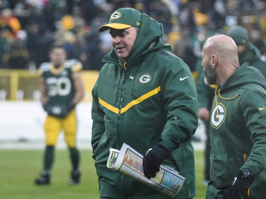 Green Bay Packers head coach Mike McCarthy walks off the field after the Packers lost to the Arizona Cardinals at Lambeau Field.