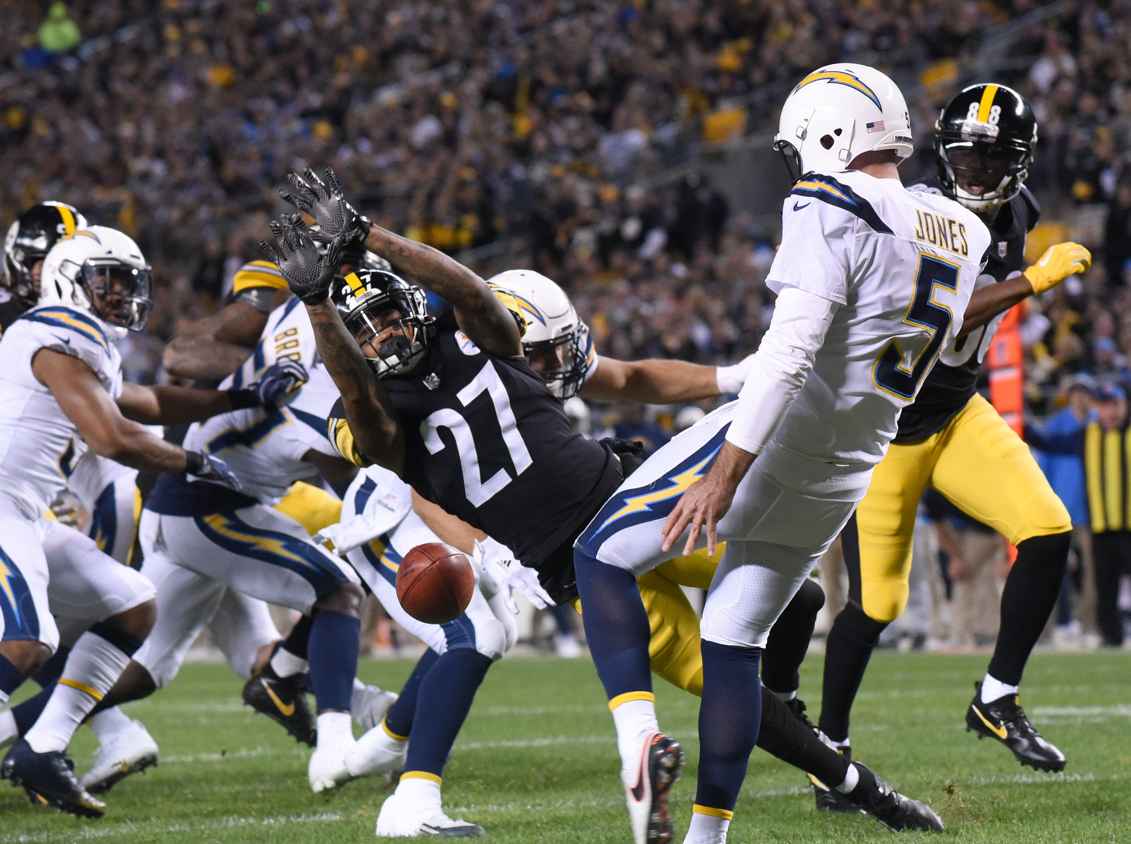 Chargers punter Donnie Jones almost has his first quarter punt blocked Steelers safety Marcus Allen.