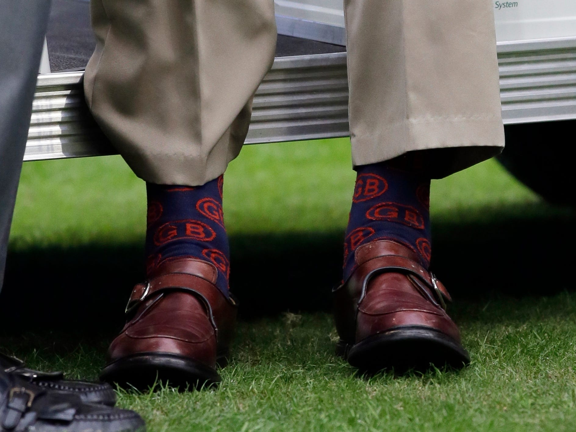 Former President George H.W. Bush wears socks with his initials at an NFL football game between the Houston Texans and the Oakland Raiders on Nov. 17, 2013, in Houston. (AP Photo/Tony Gutierrez, File) ORG XMIT: NYAJ108