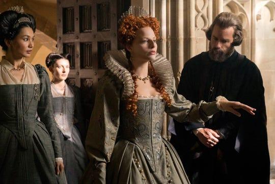 "Margot Robbie (center) reigns as Queen Elizabeth in ""Mary Queen of Scots."""