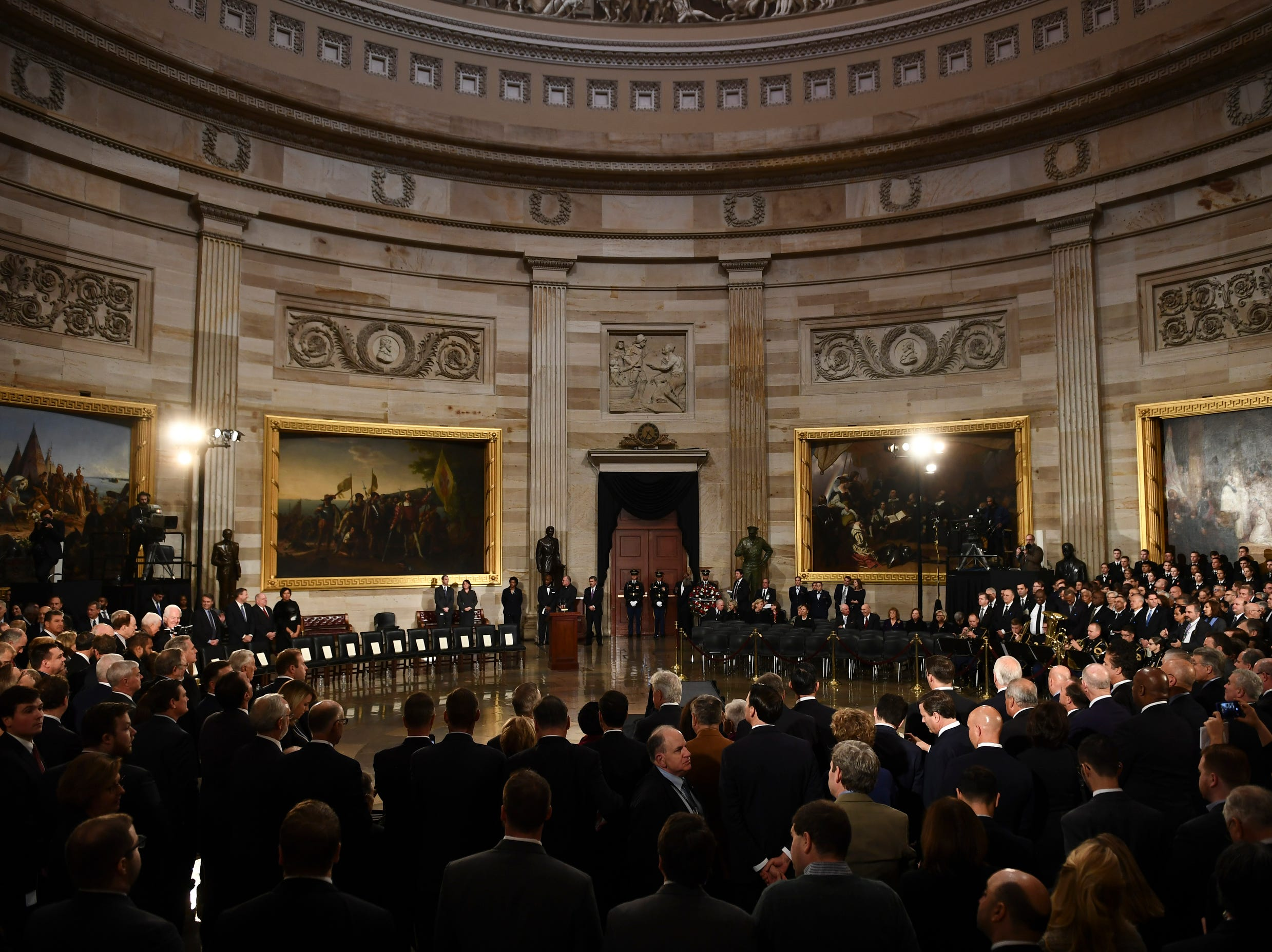 Attendees wait for the remains of former US President George H.W. Bush to arrive at the U.S Capitol Rotunda on Dec. 3, 2018.