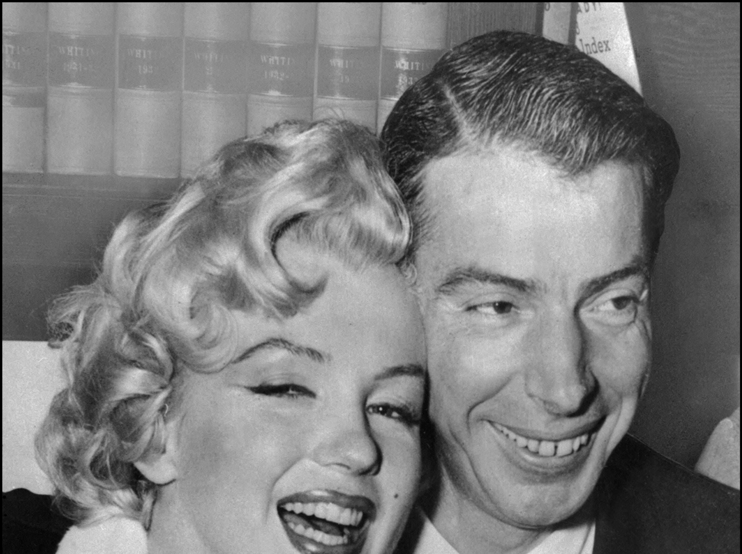 (FILE PHOTO) 14th January 2014 marks 60 years since iconic American actress Marilyn Monroe married American Baseball player Joe DiMaggio in San Francisco on January 14, 1954. DiMaggio and Monroe were divorced in October 1954, just 274 days after they were married, with the actress citing mental cruelty in the divorce petition.   SAN FRANCISCO, UNITED STATES:  Picture dated 01 April 1954 showing American actress Marilyn Monroe (L) with her husband baseball legend Joe DiMaggio during their wedding ceremony at San Francisco City hall. (Photo credit should read AFP/AFP/Getty Images) ORG XMIT: 156616713 ORIG FILE ID: 51656364