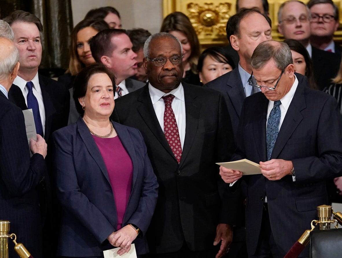 Associate Justices Brett Kavanaugh, left, Elena Kagan, Clarence Thomas, and Chief Justice John Roberts arrive at the Capitol Rotunda. Former President George H.W. Bush will lie in state in the Capitol Rotunda before his state funeral at the Washington National Cathedral on Dec. 5.
