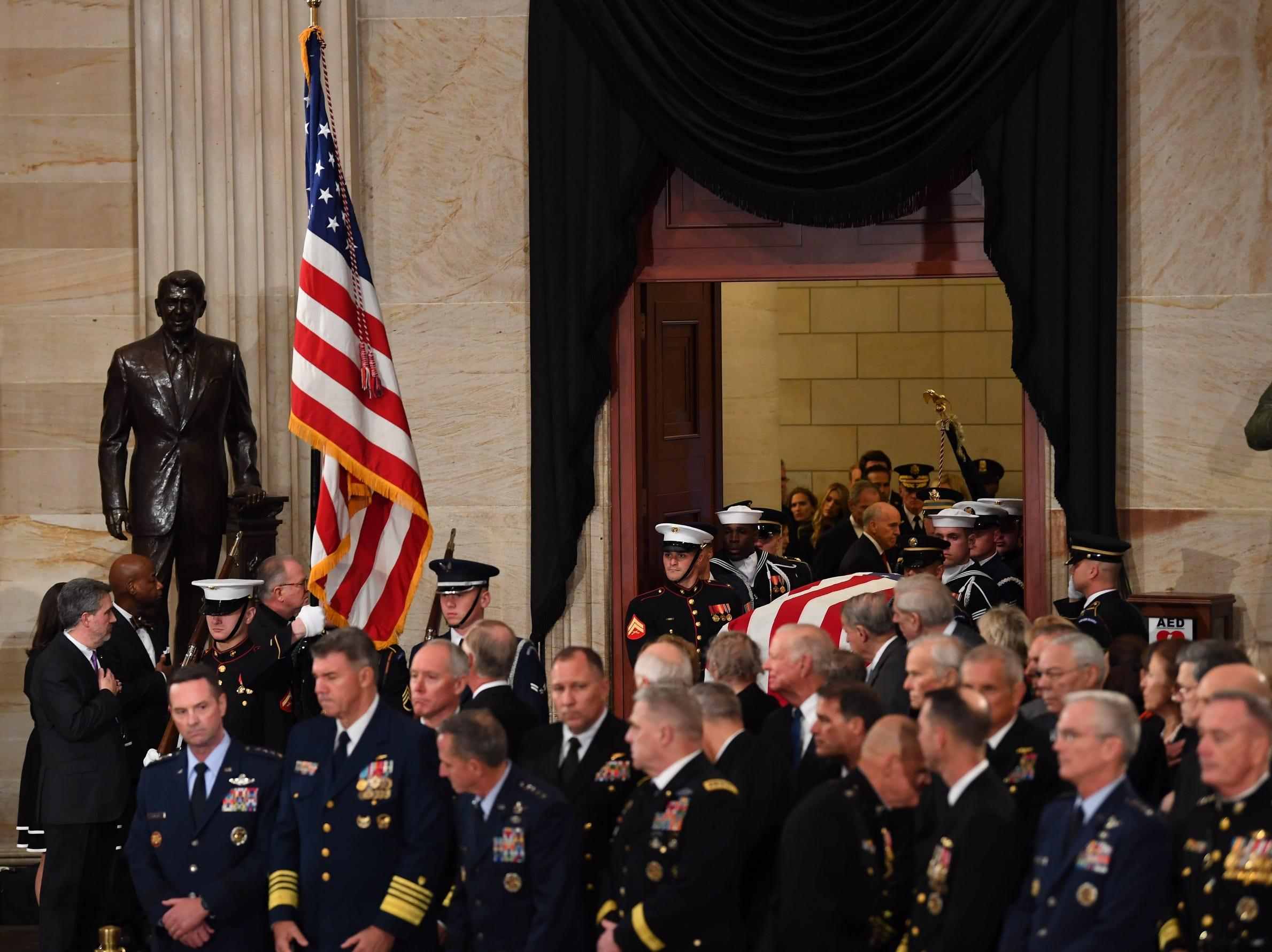Honor guards bear the casket of former U.S President George H.W. Bush into the U.S. Capitol Rotunda.