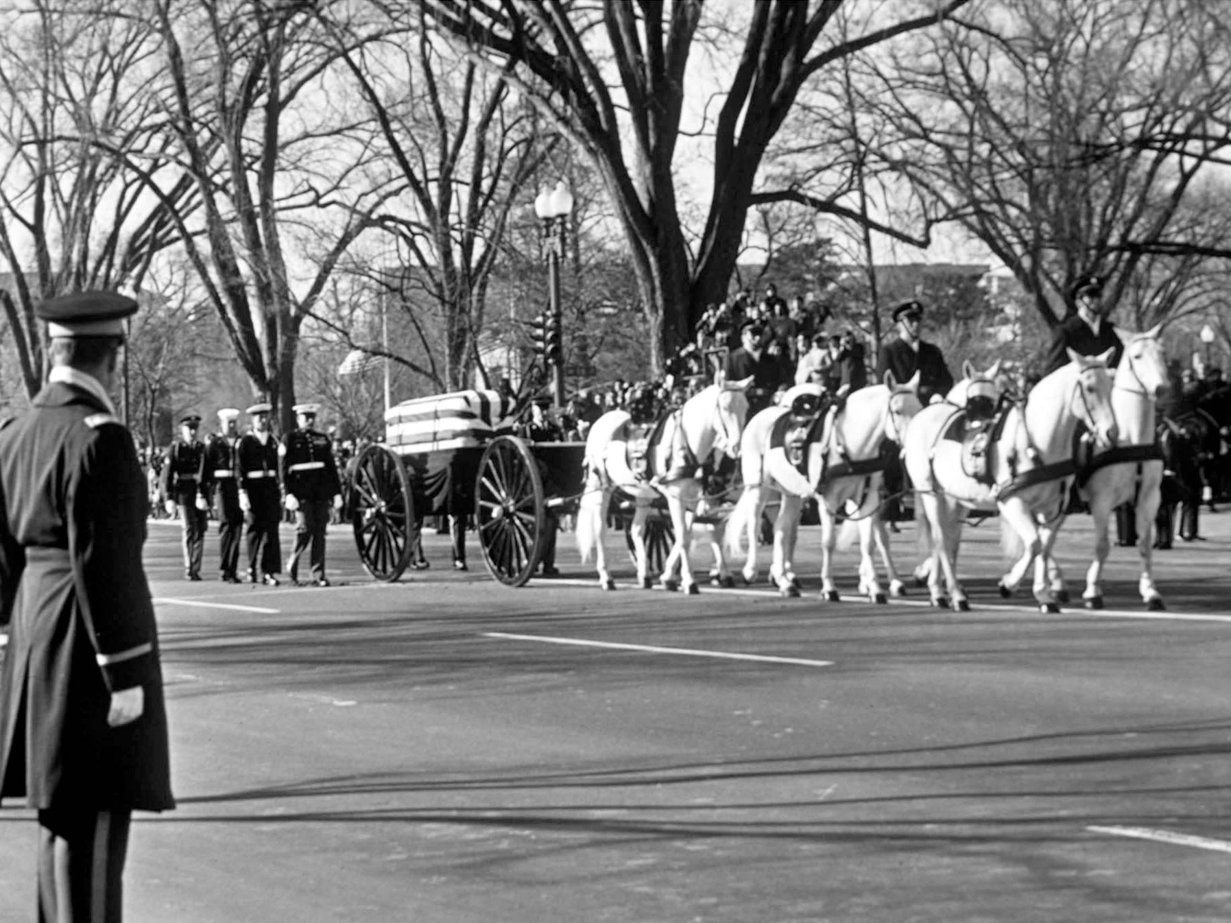 The horse-drawn caisson carrying the body of former President Lyndon B. Johnson moves down Constitution Avenue in Washington, Jan. 24, 1973, on the way to the Capitol.