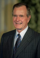 "FILE--Former President George Bush, shown in this 1992 file photo,  has dropped his lifetime  membership in the National Rifle Association in outrage over its references  to federal agents as ""jack-booted government thugs.'' ""Your broadside against federal agents deeply offends my own sense of decency and honor, and it offends my concept of service to country,'' Bush  said in a letter to Thomas L. Washington, president of the firearm-owners'  organization.    (AP Photo/Ron Edmonds) ORG XMIT: NY127"