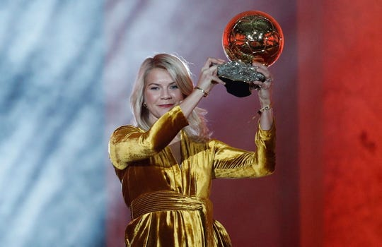Ada Hegerberg holds her Ballon d'Or during the ceremony held in Paris.