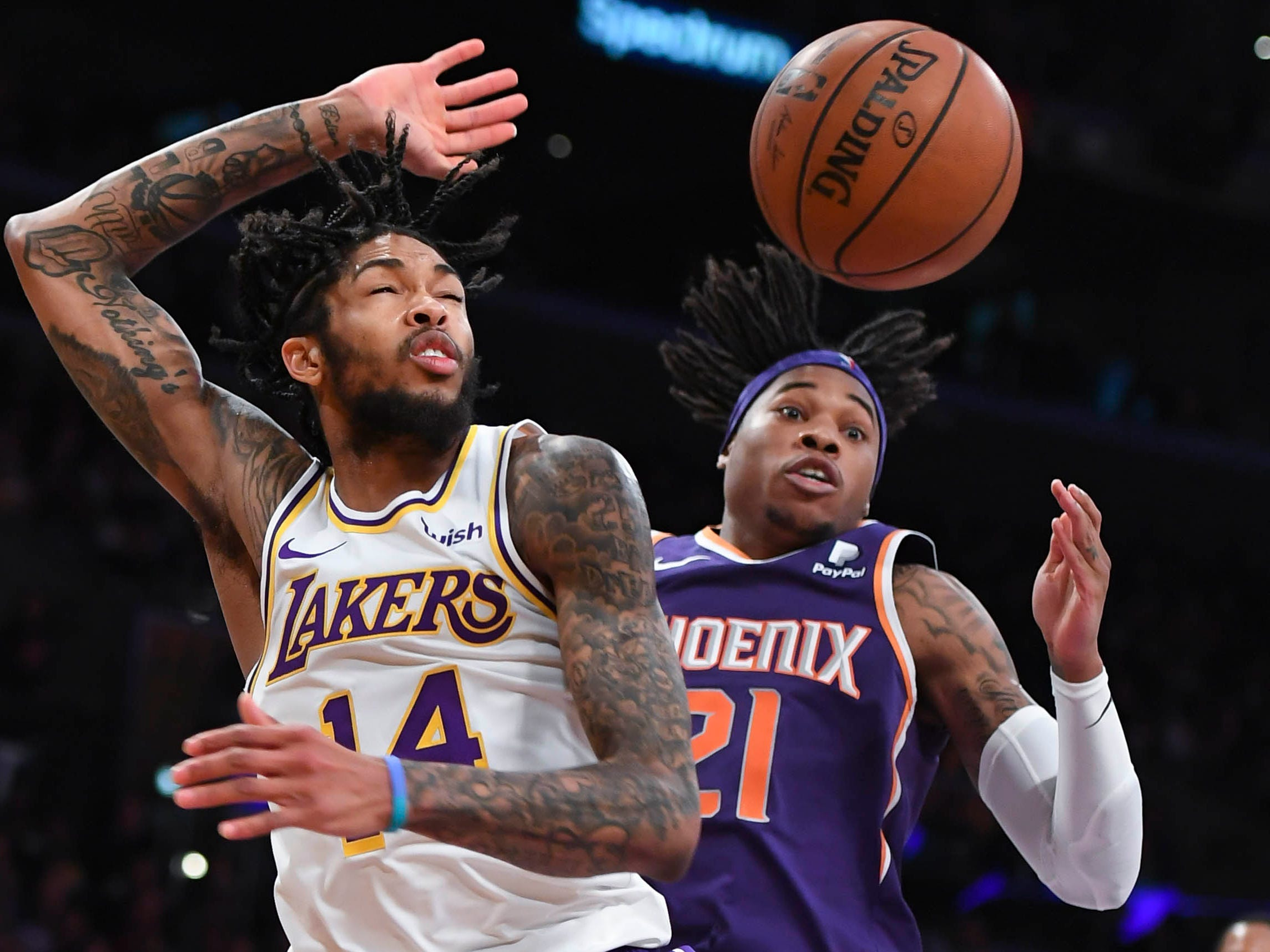 Dec. 2: Suns defender Richaun Holmes (21) fouls Lakers forward Brandon Ingram (14) on a second-half drive to the basket in Los Angeles.